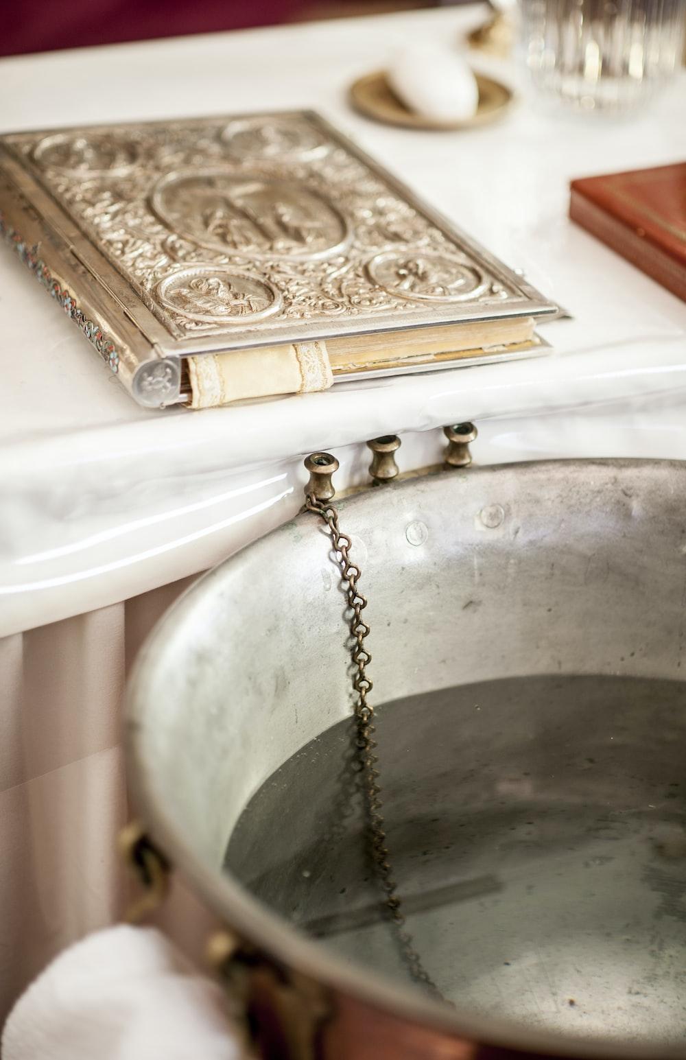 silver round shower head on white bathtub