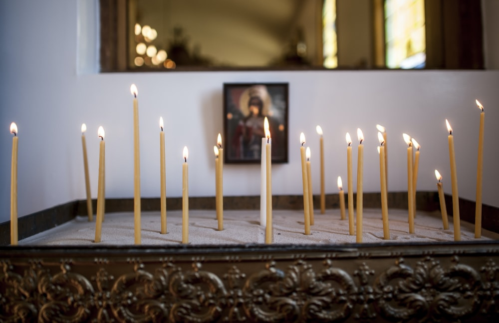 white candles on brown wooden table