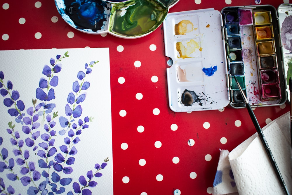 white and blue floral ceramic plate on red and white polka dot table cloth