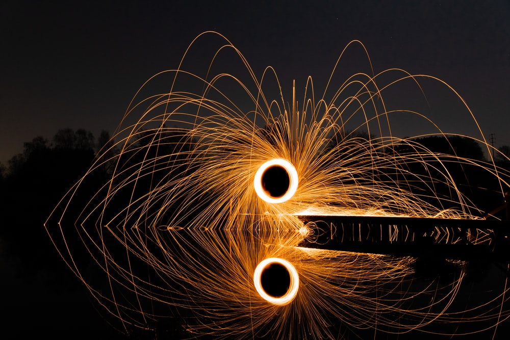 steel wool photography of fireworks during night time