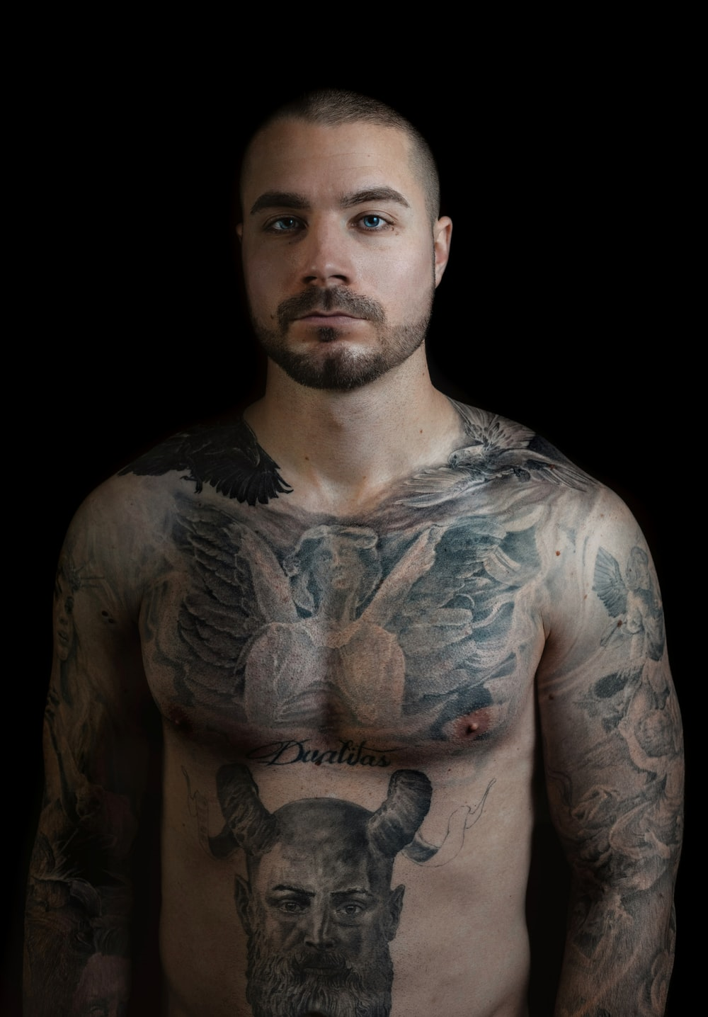 man with black and white body tattoo