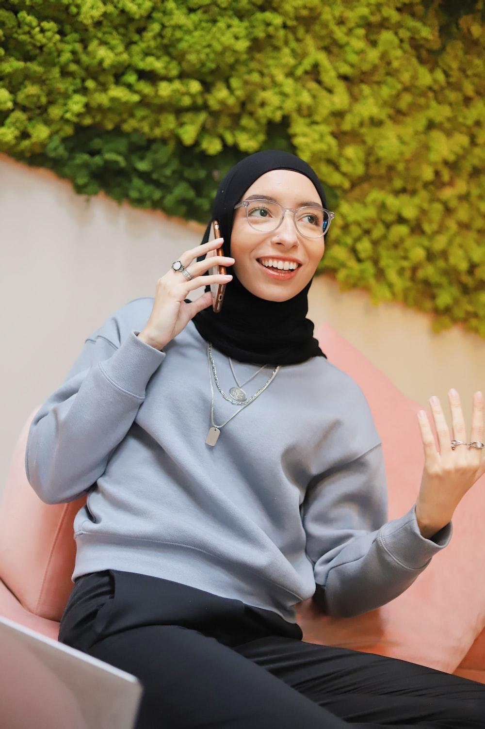 woman in gray sweater and black hijab