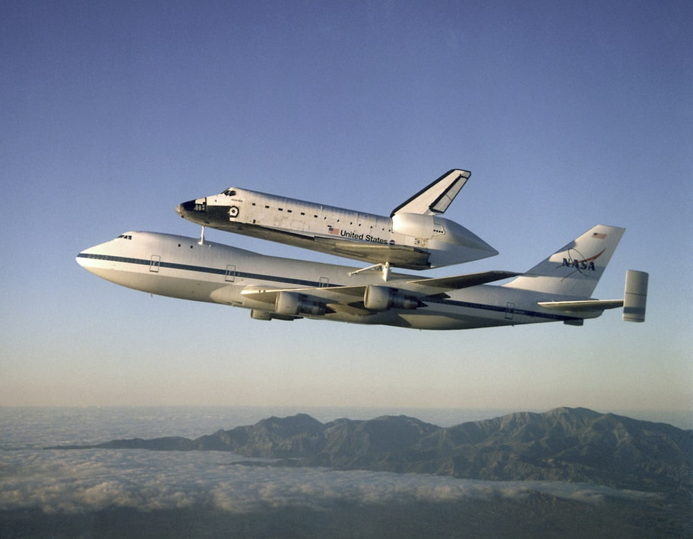 Airplane carries space shuttle in flight