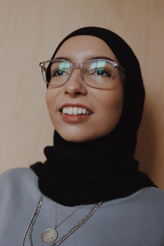 woman in black hijab wearing eyeglasses