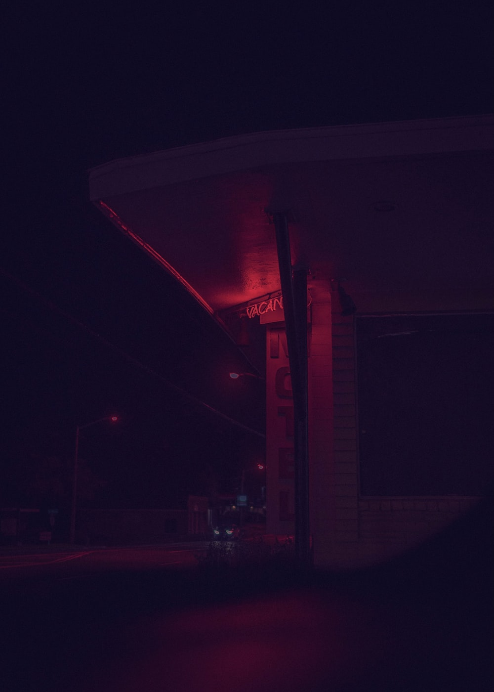 white and red building during night time