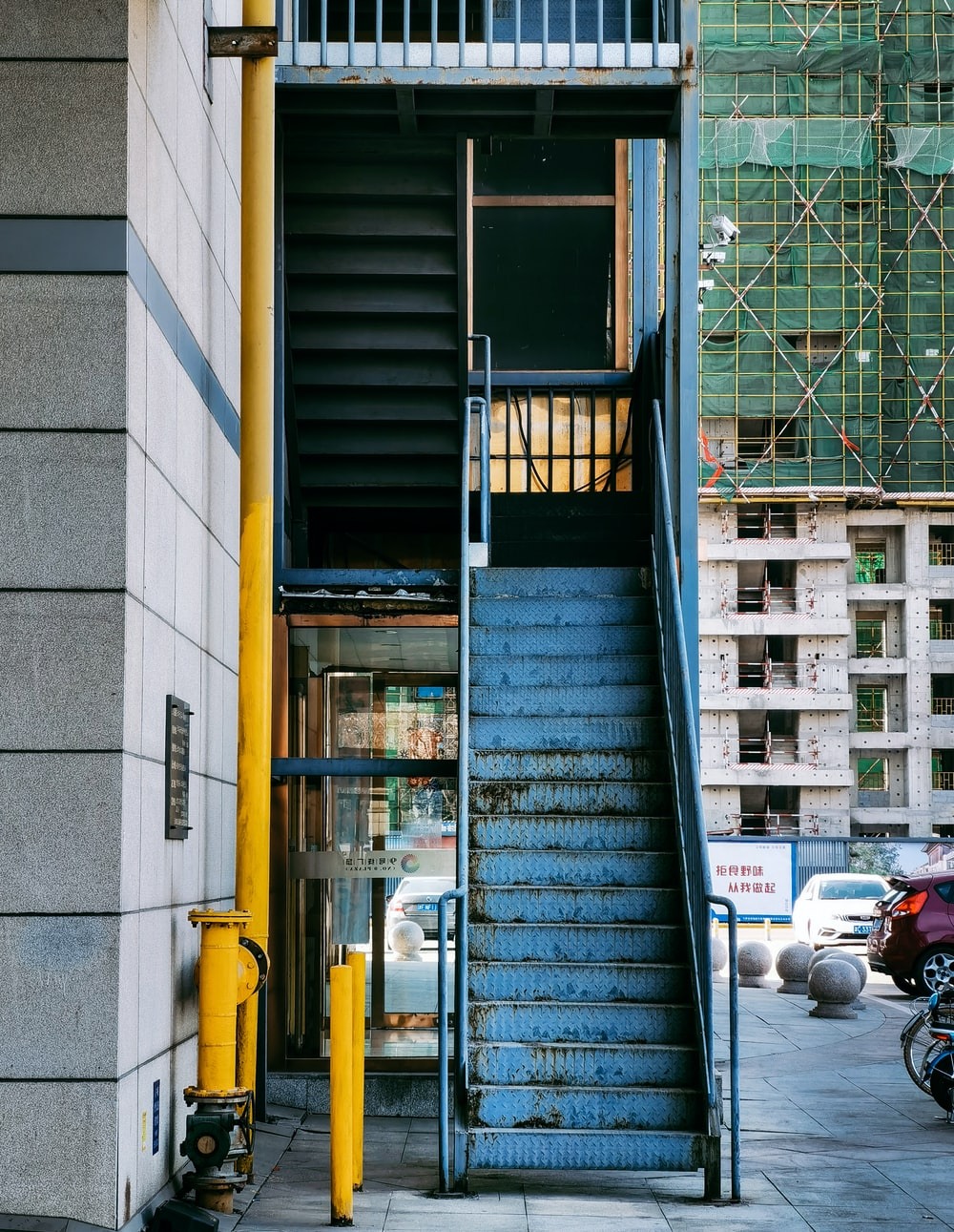 blue and yellow steel stair