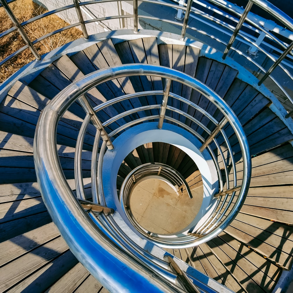 blue spiral staircase with blue railings