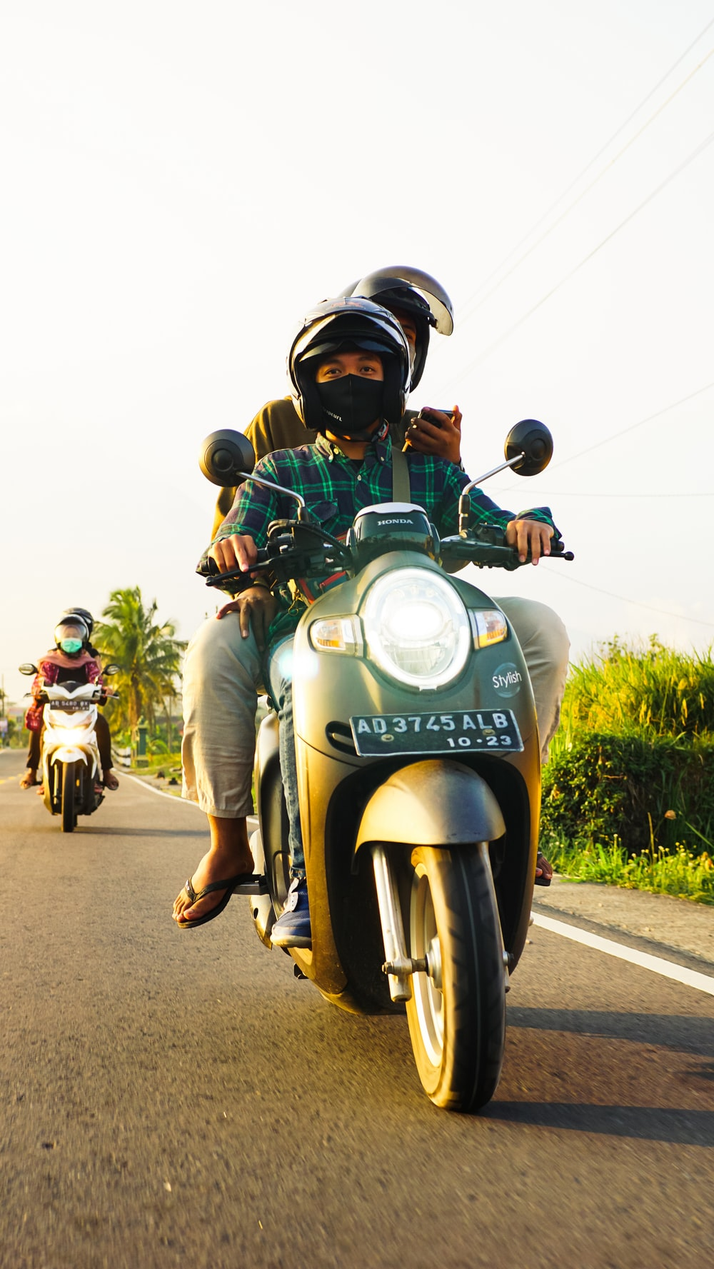 people riding motorcycle on road during daytime