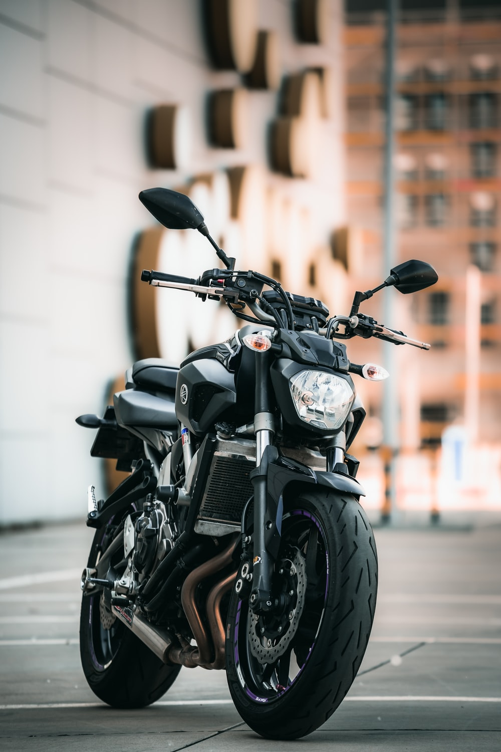 black motorcycle parked on the street