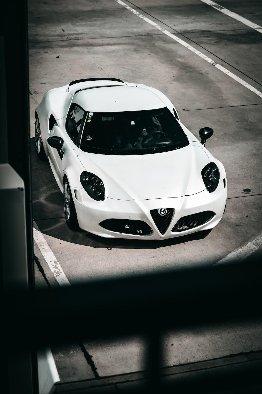 white porsche 911 parked on parking lot