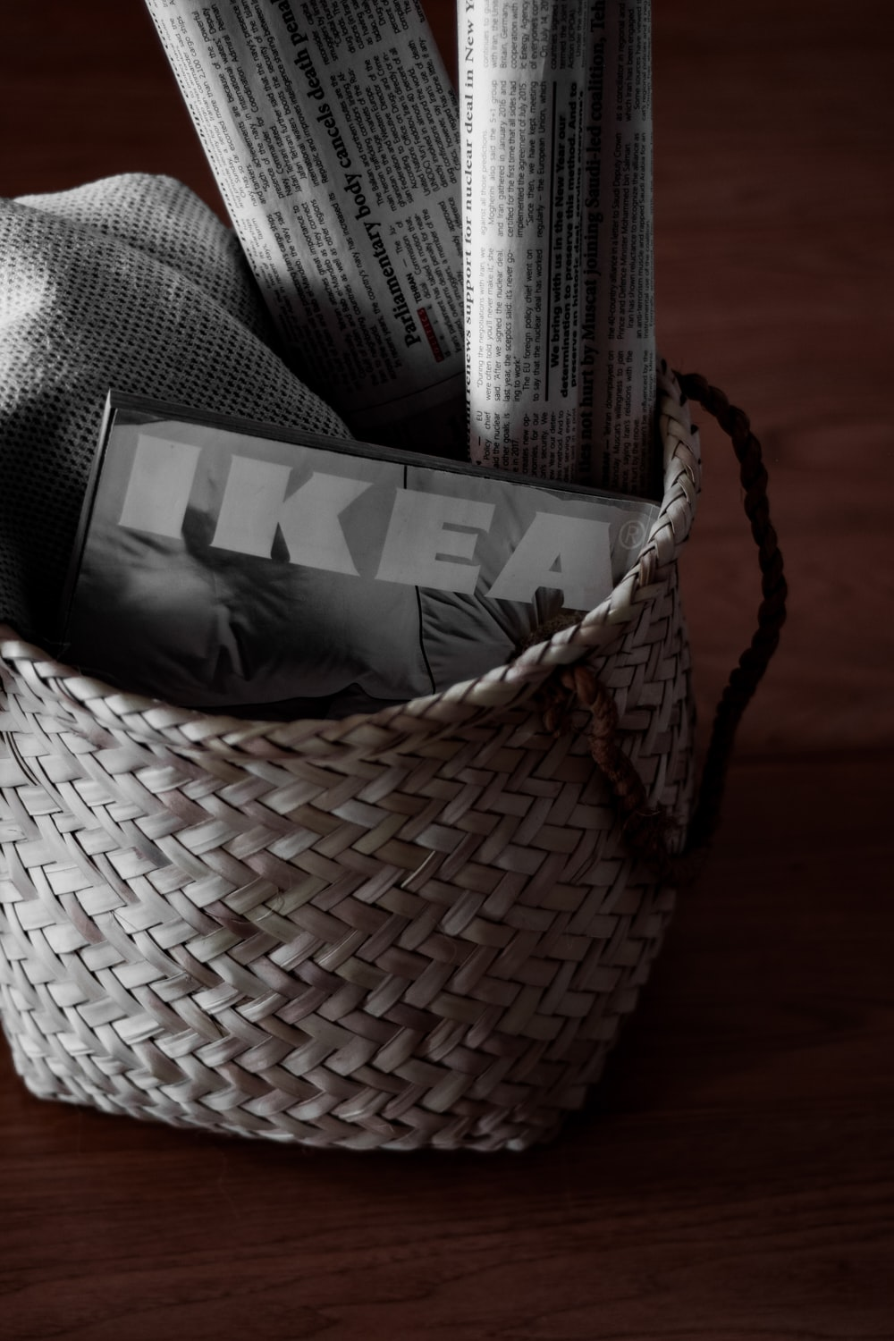 black and white plastic pack in brown woven basket