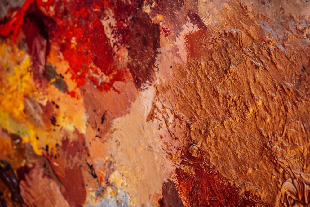 red white and brown abstract painting