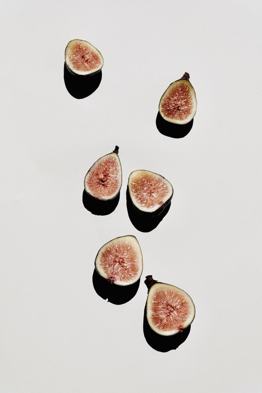 sliced pomegranate fruit on white table