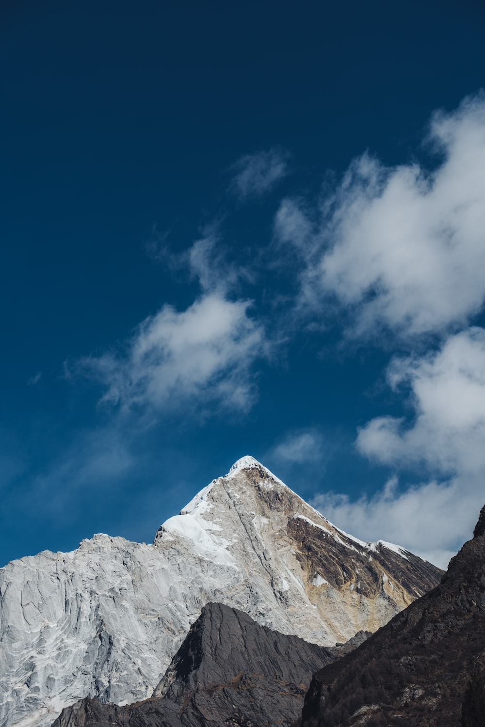white and gray rocky mountain under blue sky during daytime