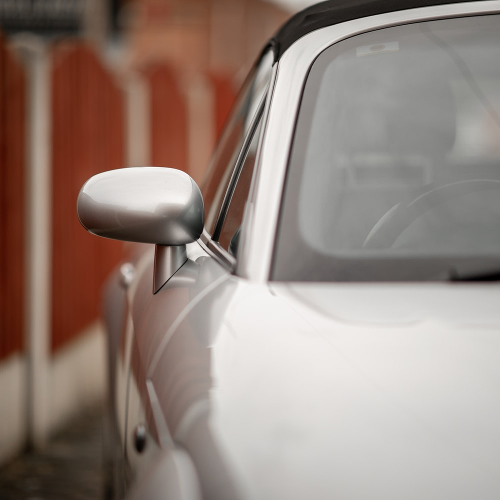 white car in the street during daytime