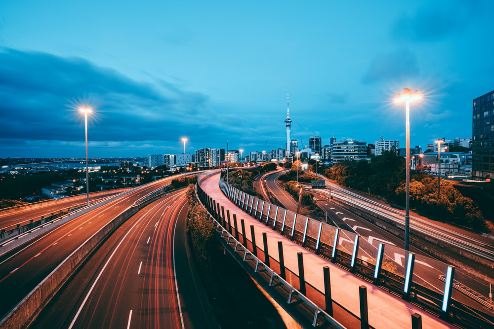 time lapse photography of city road during night time