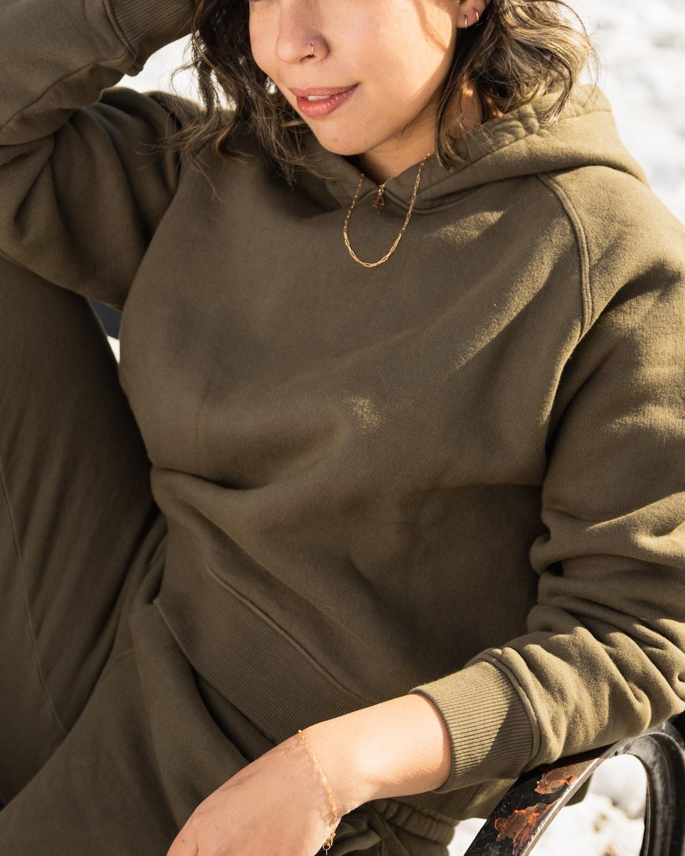 woman in brown zip up jacket