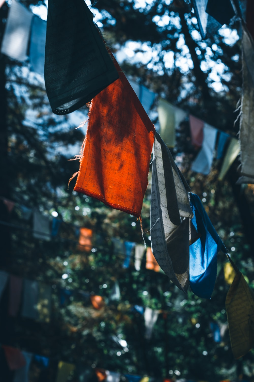 orange and blue textile hanging on black metal bar