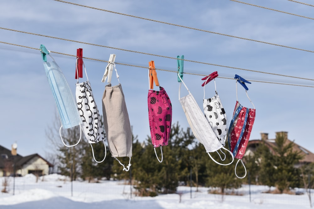 assorted clothes hanging on clothes line