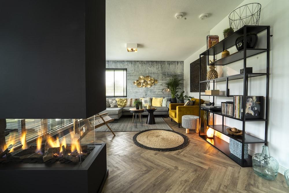 black fireplace near black flat screen tv