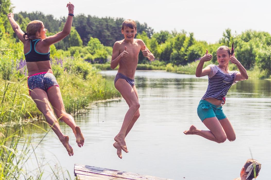 kids swimming in lake