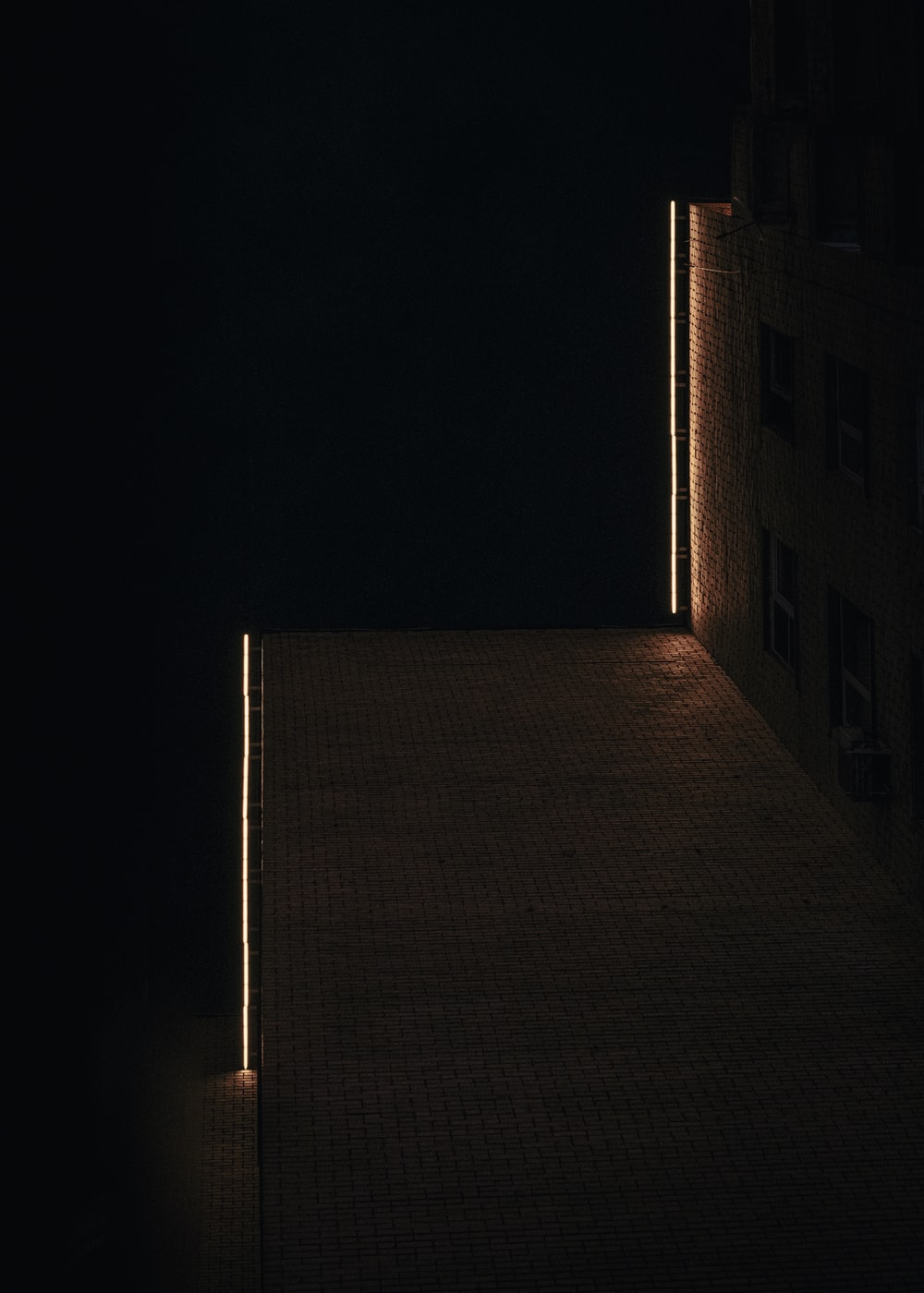 brown brick building during night time
