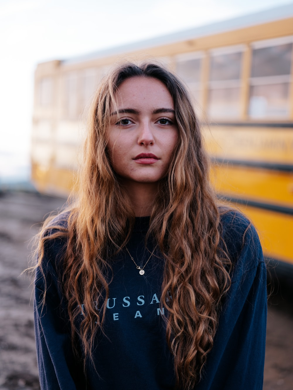 woman in blue and white long sleeve shirt