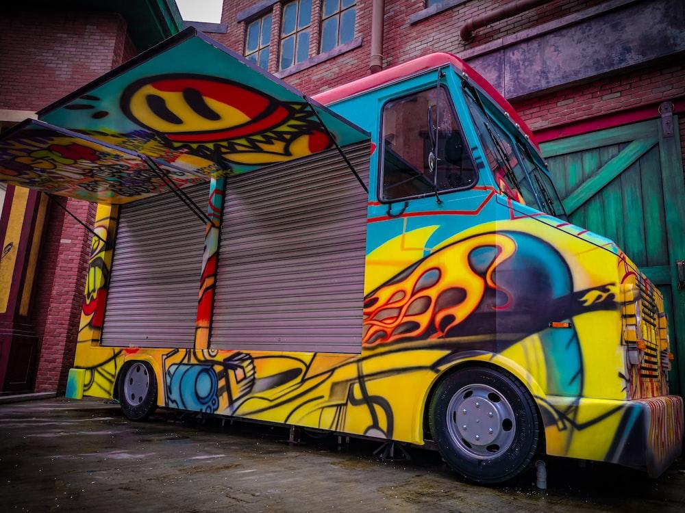 blue and yellow volkswagen t-1 van