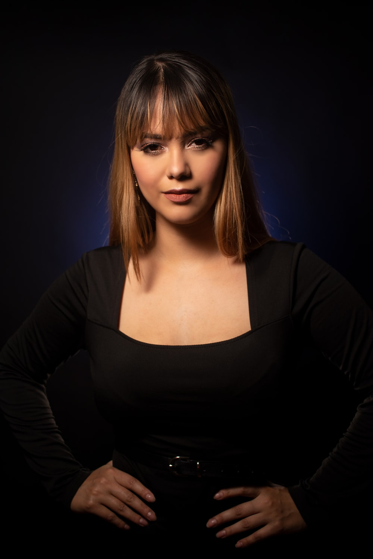 woman in black scoop neck long sleeve shirt