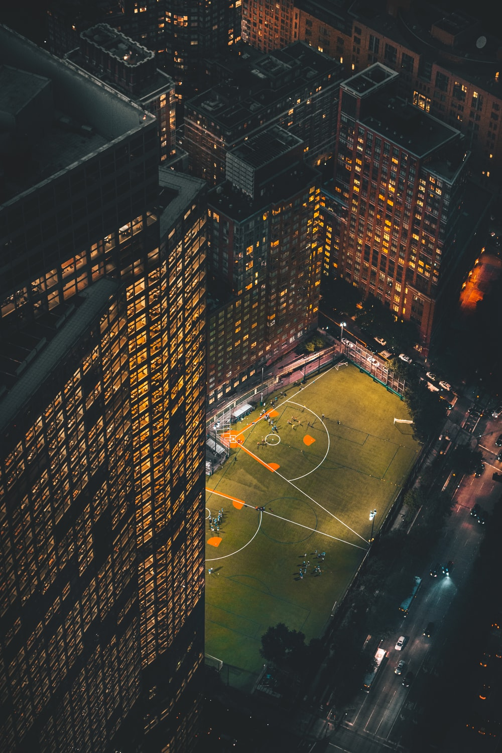 aerial view of basketball court during night time