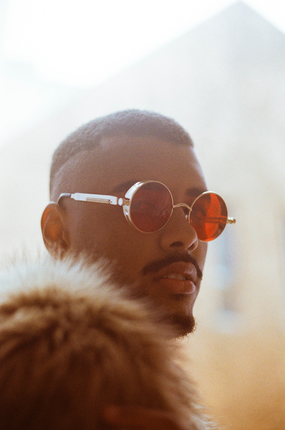 man wearing silver framed aviator style sunglasses
