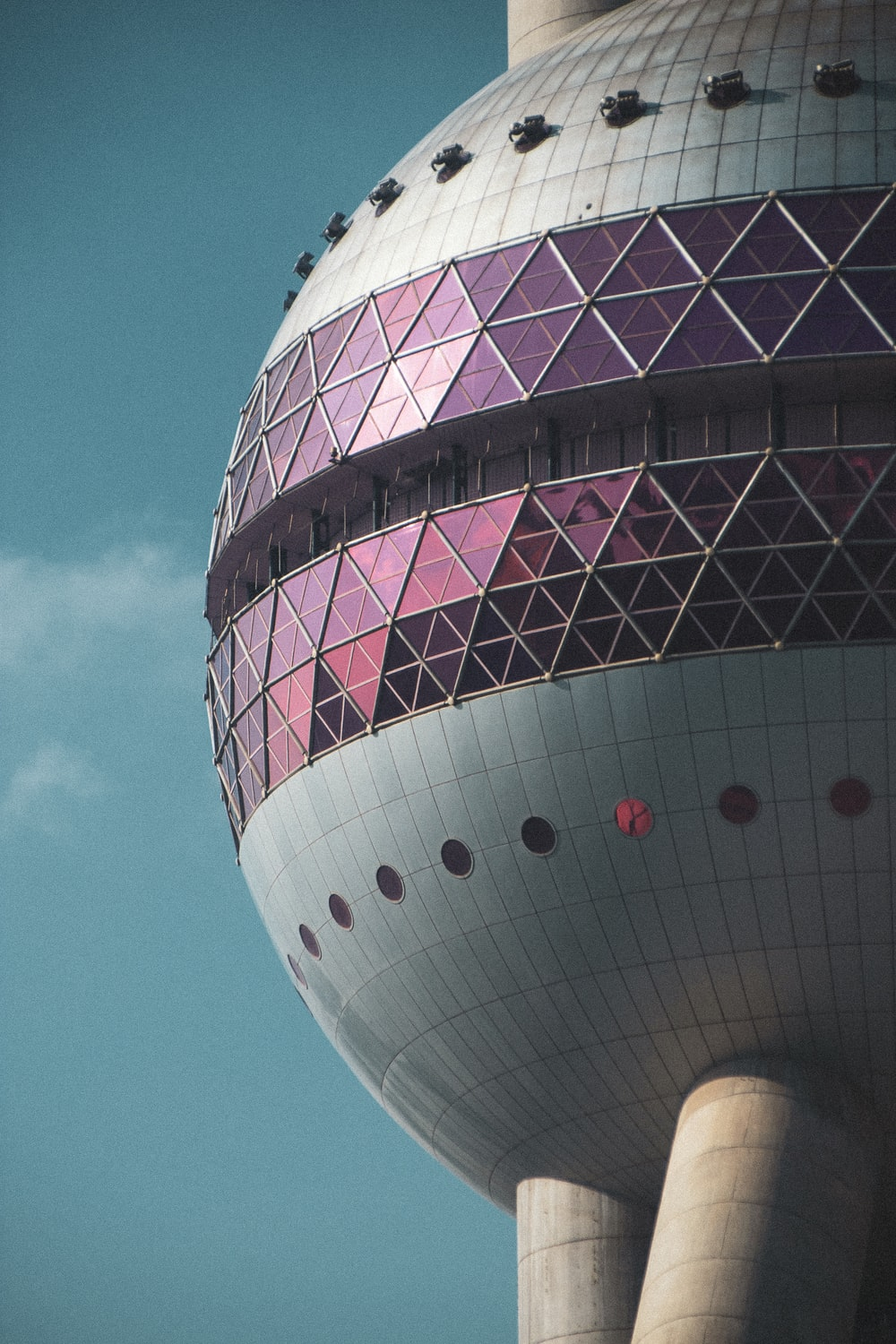 white and purple round building under blue sky during daytime