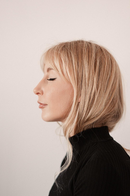 woman in black turtleneck shirt