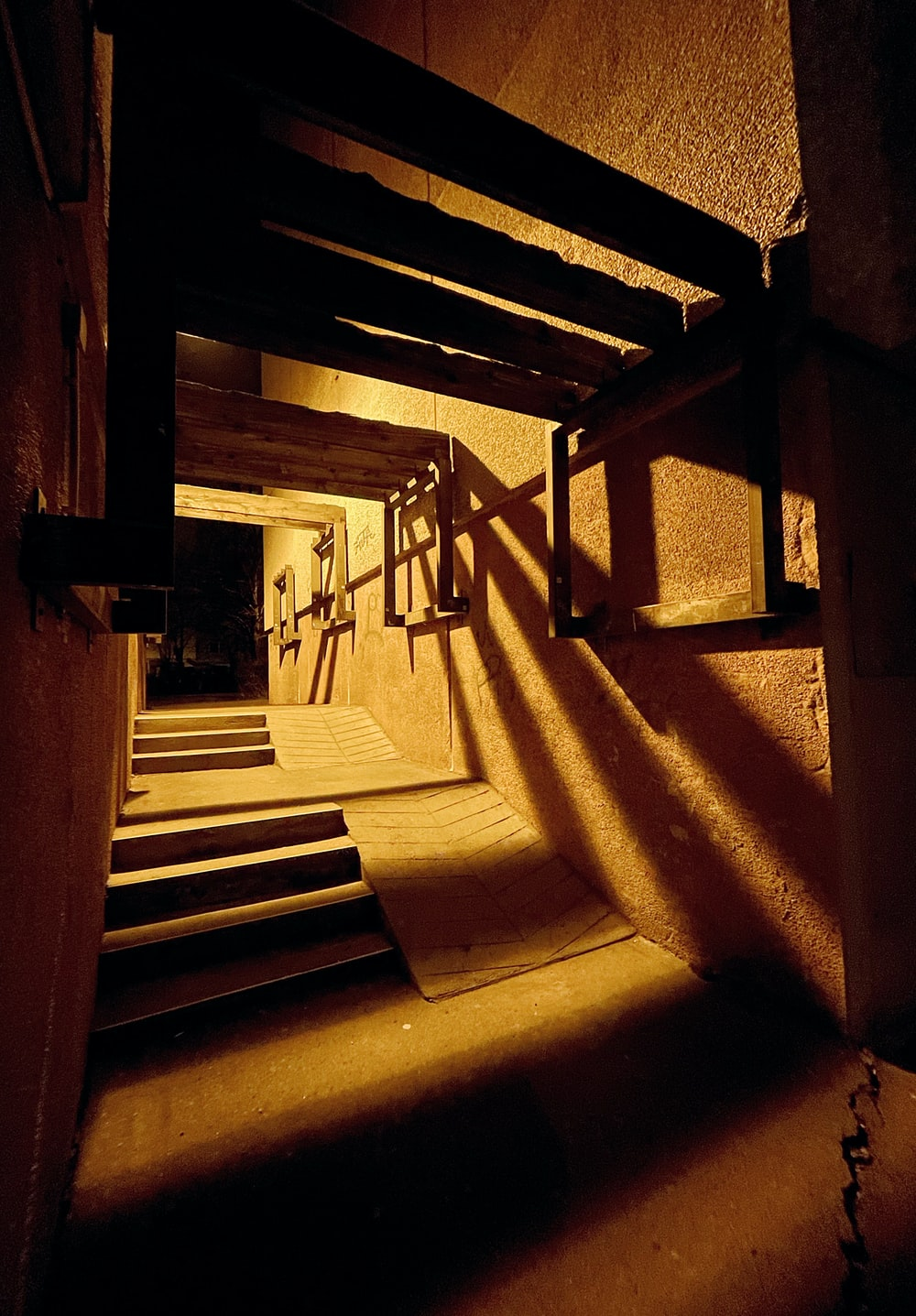 brown wooden staircase with brown wooden railings