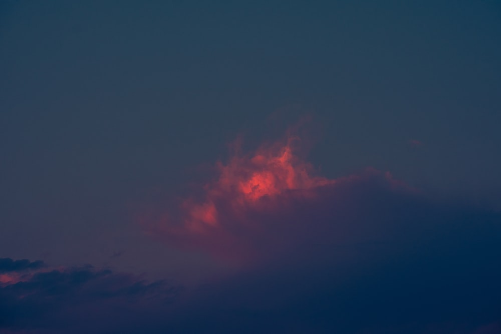 red and black clouds during night time