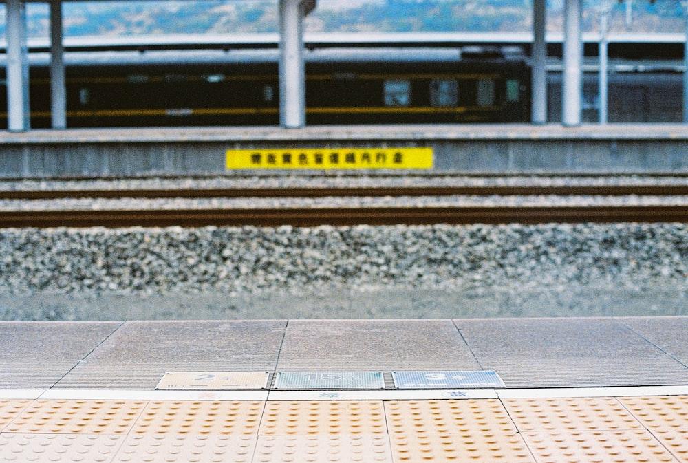 yellow and black train rail