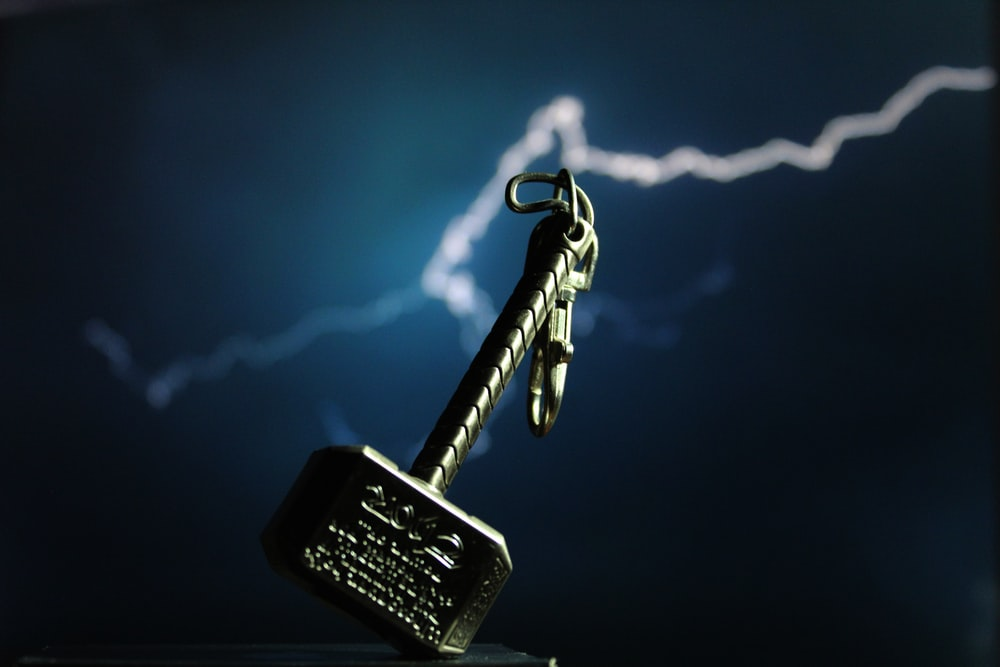 silver skeleton key with black and silver key