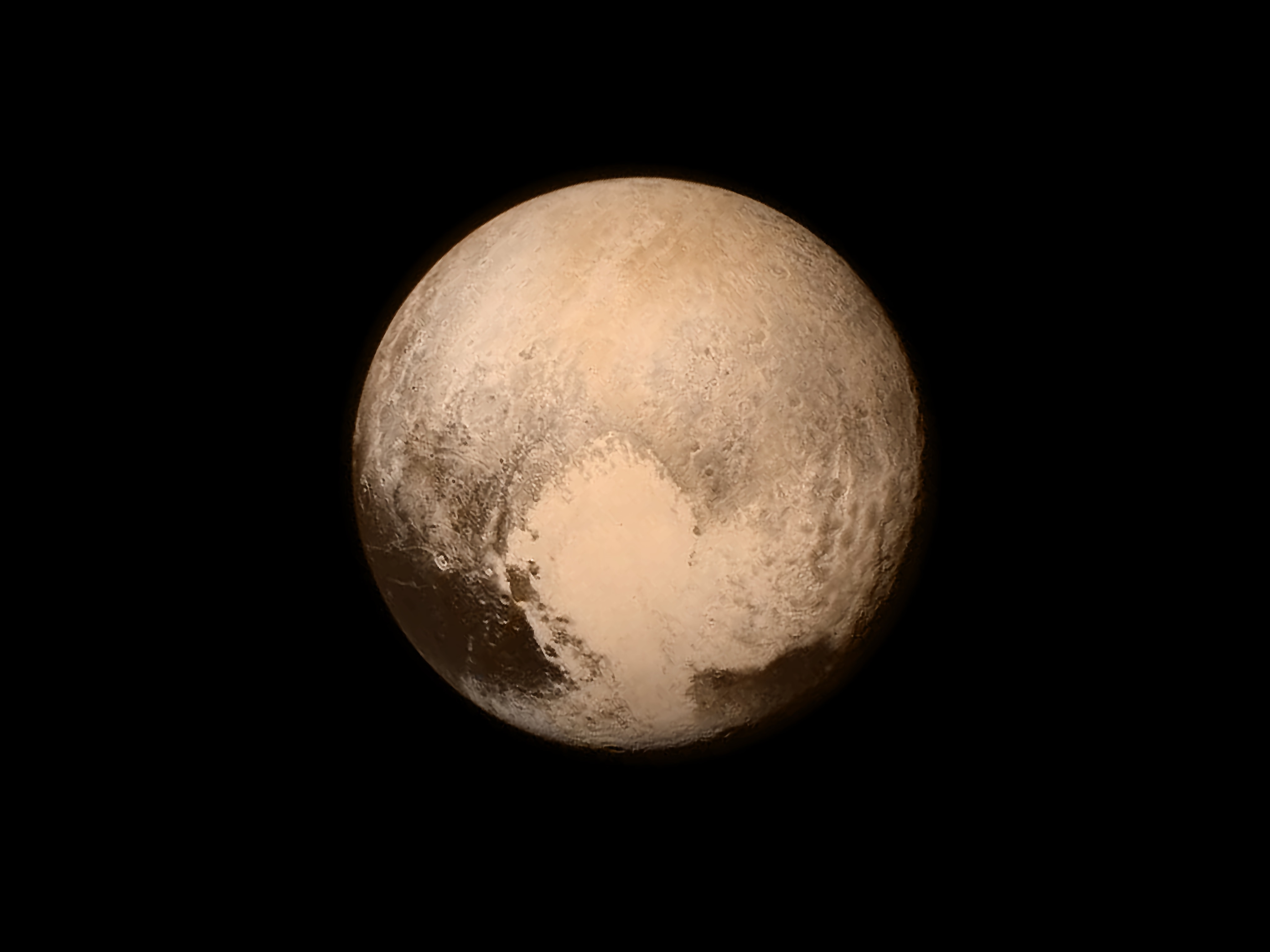 Pluto as seen from the New Horizons spacecraft in 2015 at a distance of 476,000 miles