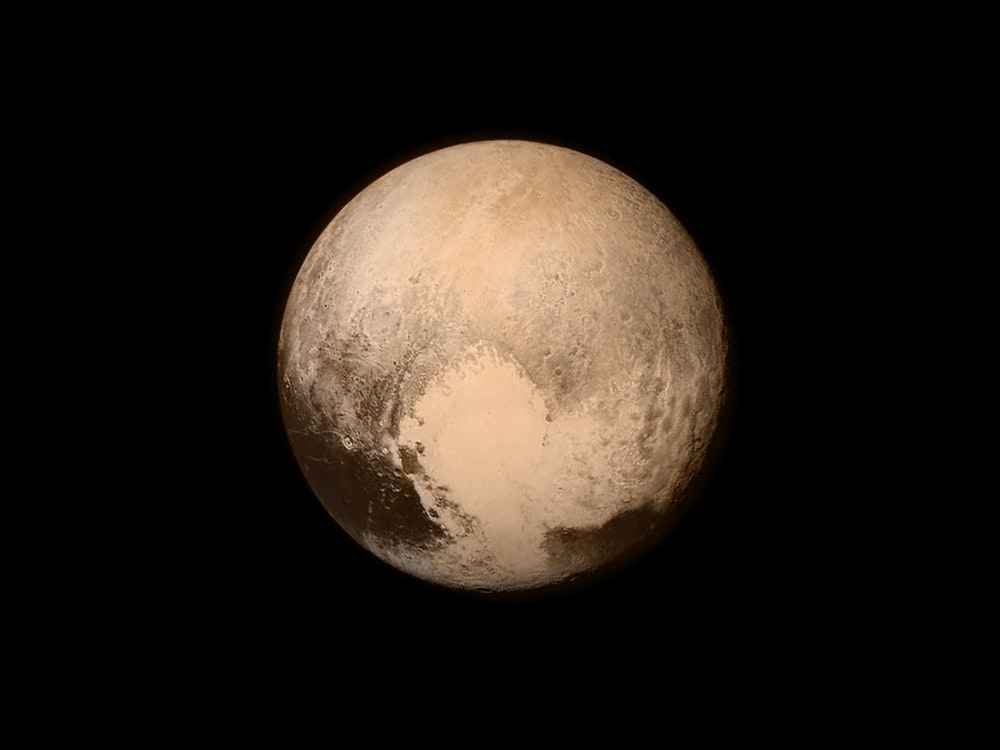Pluto on a black background