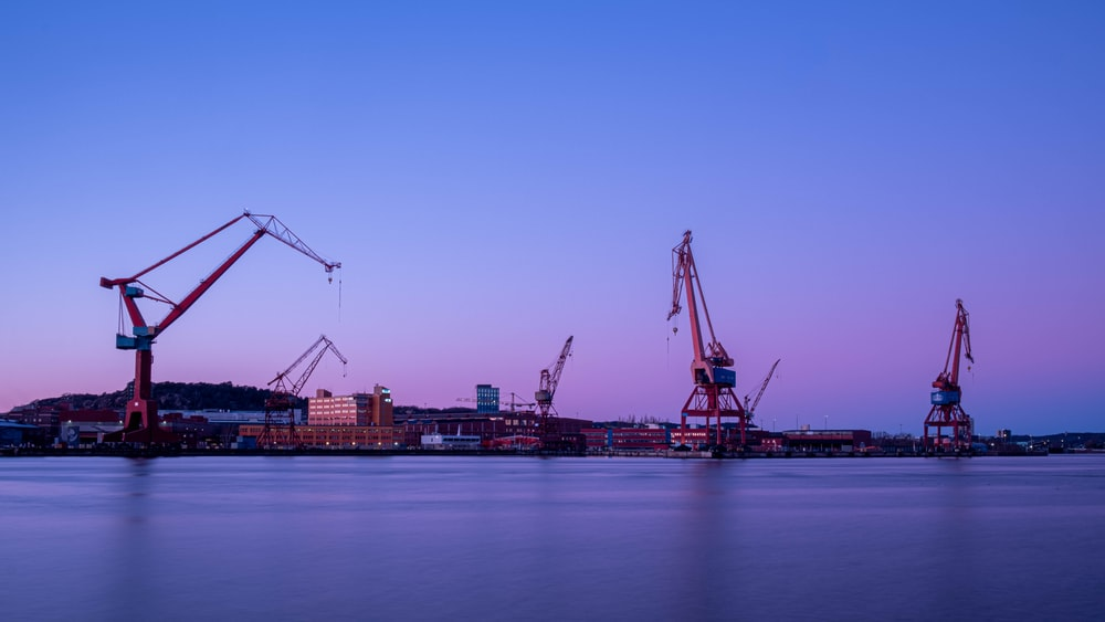 crane near body of water during daytime