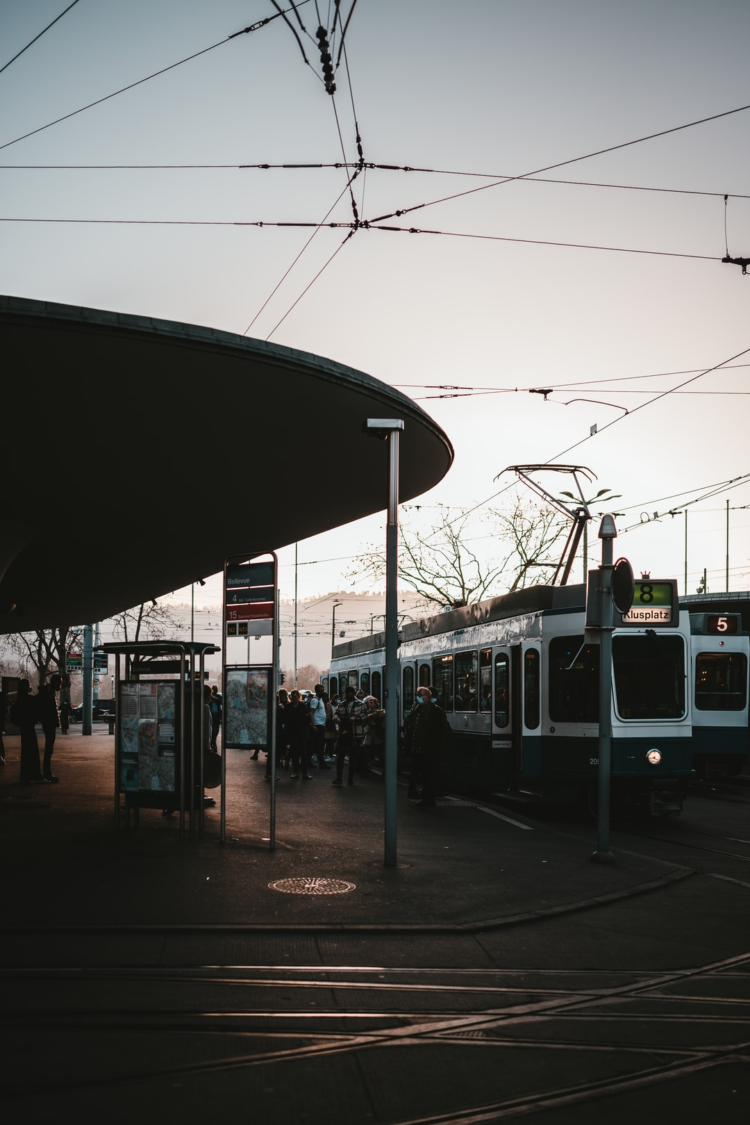 white and black train on train station during daytime