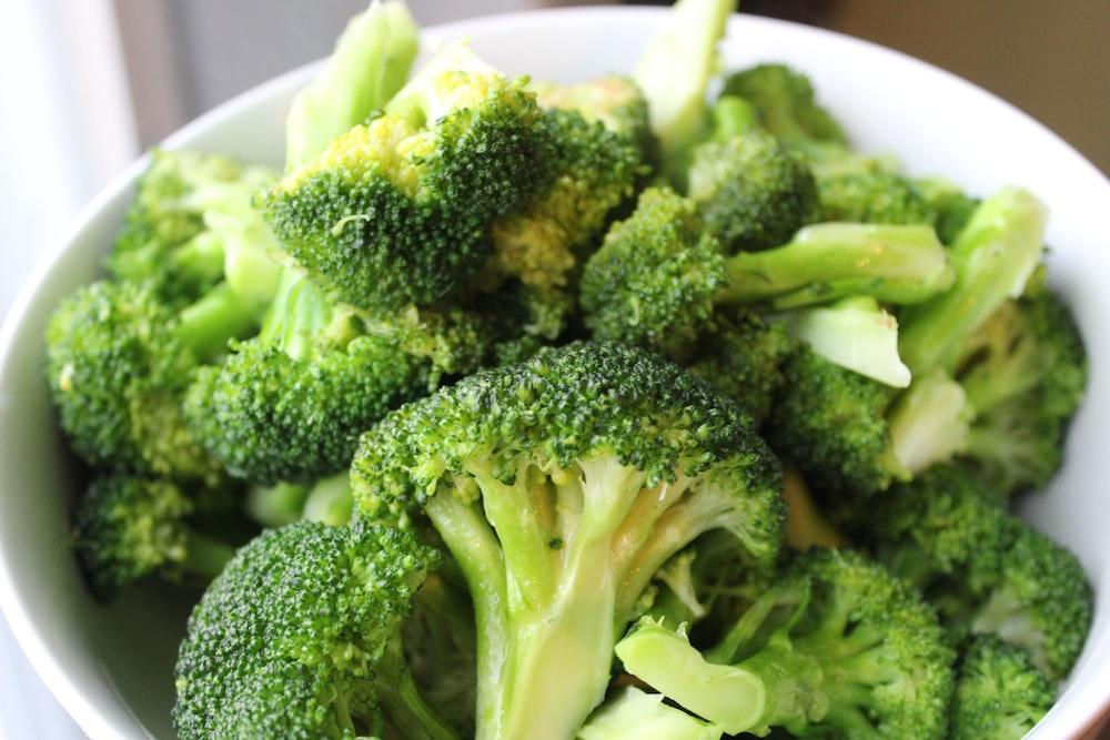 green broccoli on white ceramic plate