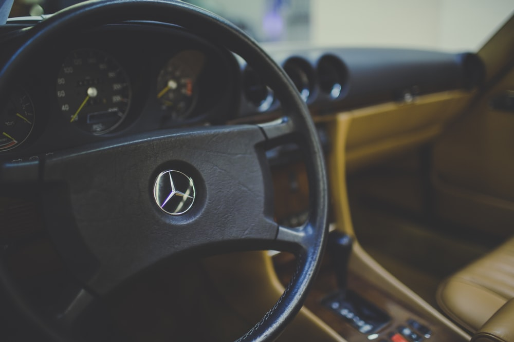 black and brown steering wheel