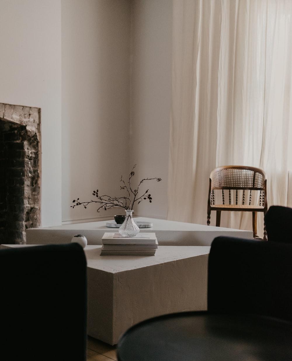 white ceramic plate on white table