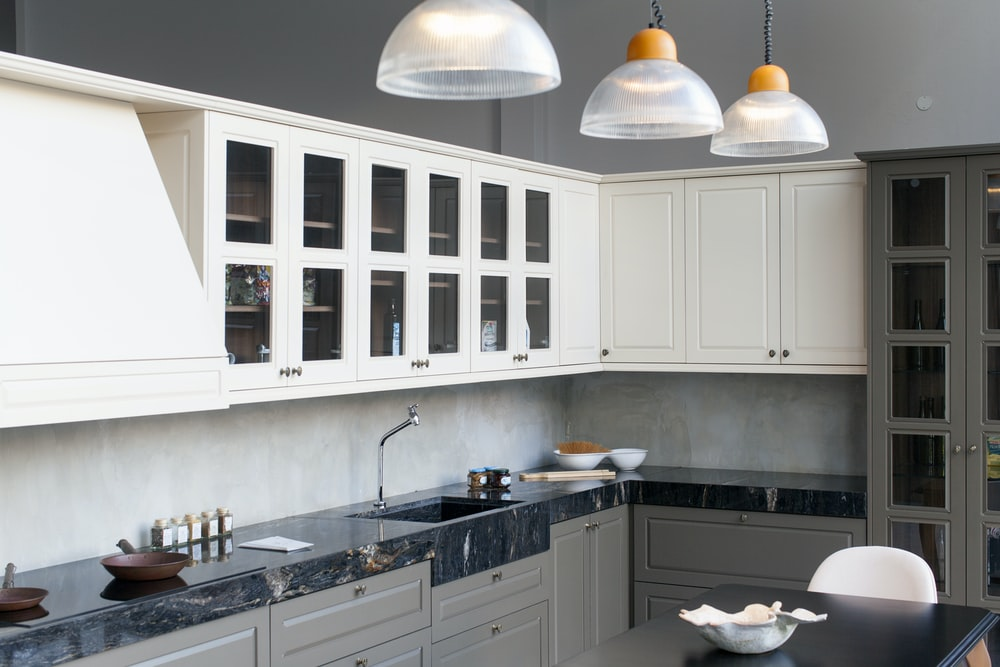 white pendant lamp turned on in kitchen