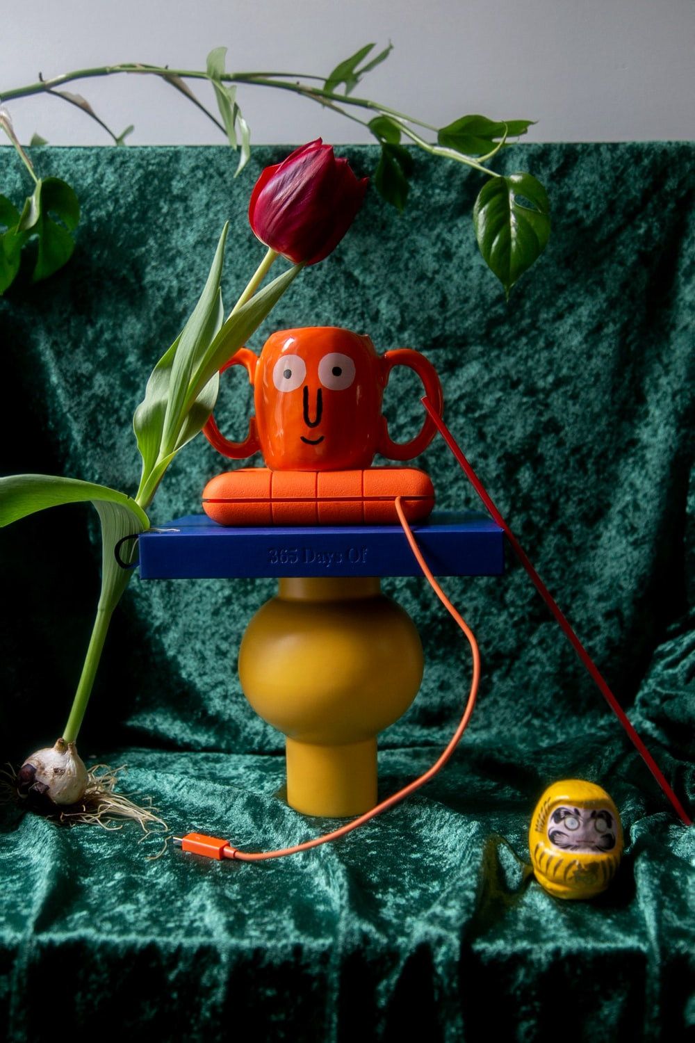 yellow and red plastic toy on green leaves