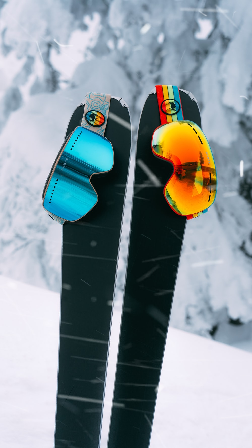 red and yellow snowboard on snow covered ground