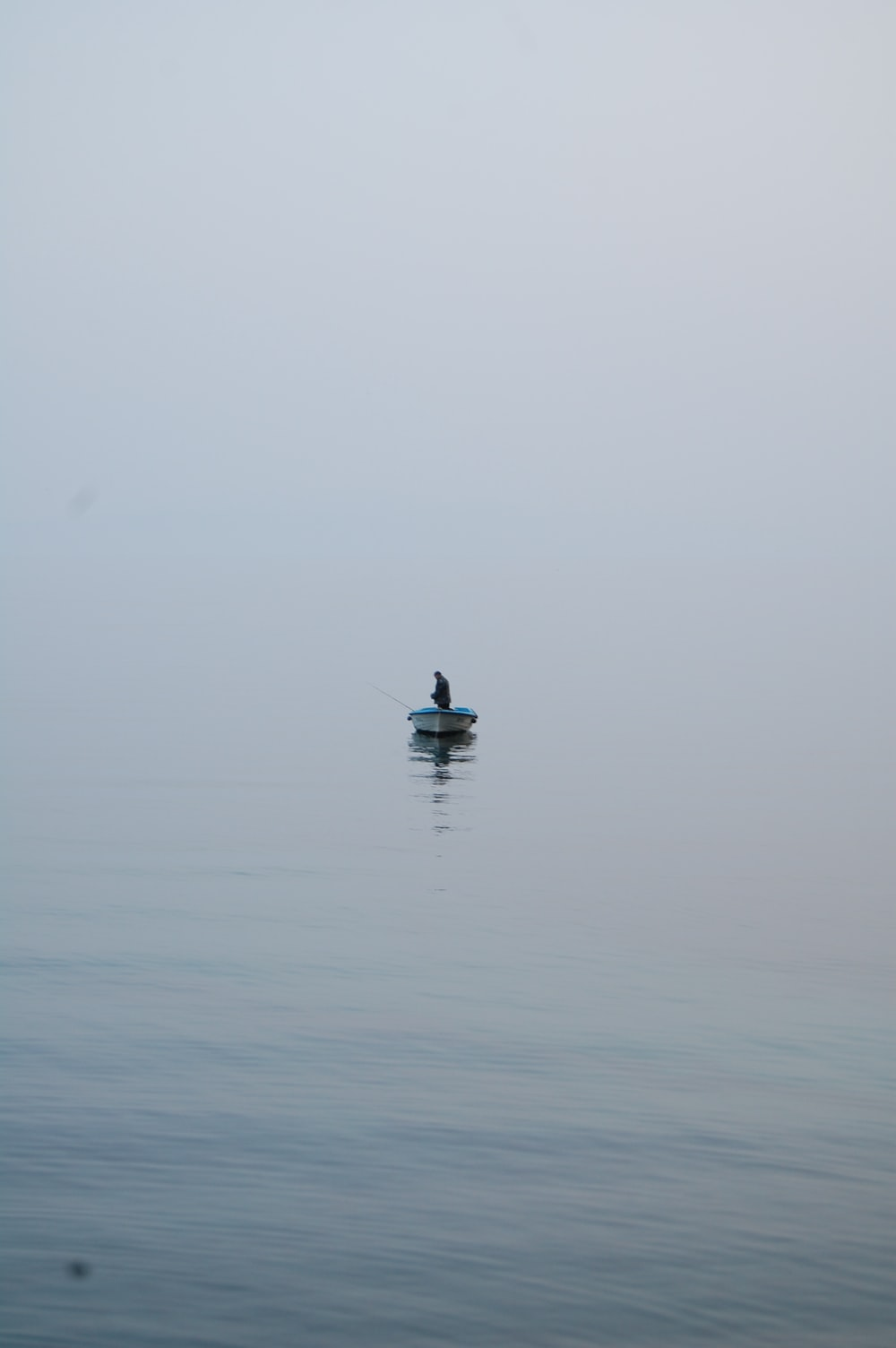 person in boat on body of water during daytime