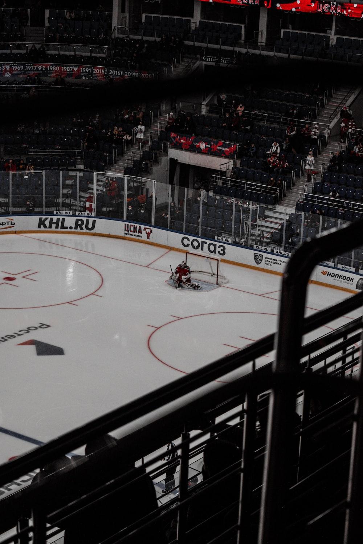 people playing ice hockey on ice hockey stadium