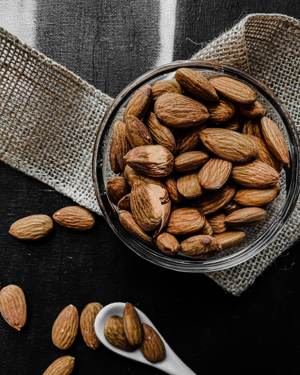 brown almond nuts on stainless steel bowl